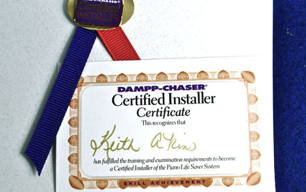 Photo of documentation of Keith Akins as Certified Dampp Chaser Piano Life Saver System Installer.