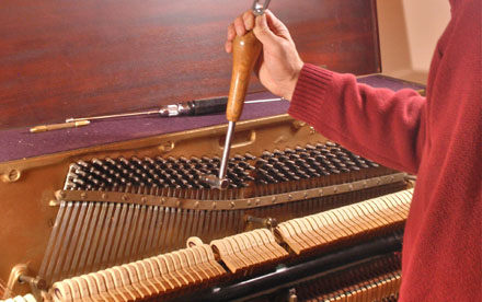 Photo Keith Akins, RPT tuning a piano by ear according to Steinway's recommendation.